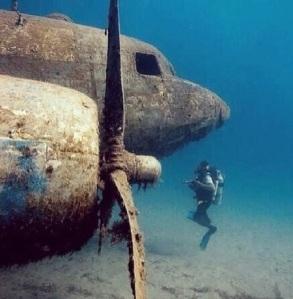 scuba diver and airplane propeller underwater Rico Besserdich